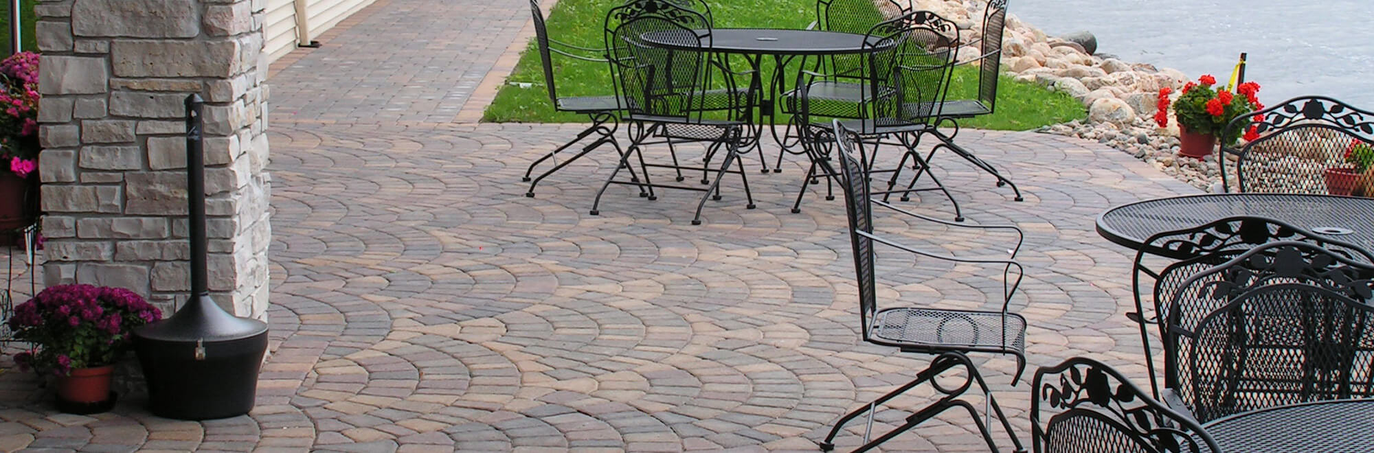 Commercial paver patio installed in an arc pattern